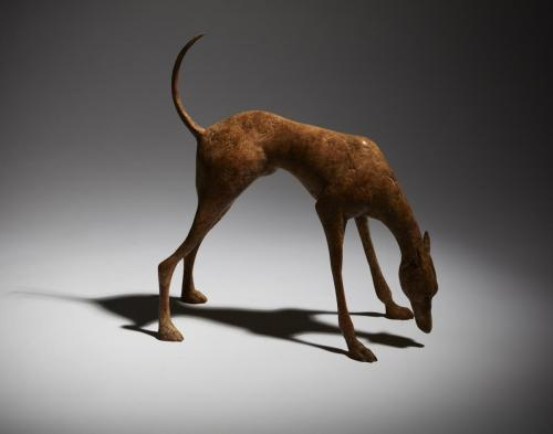 Still life of of fine art bronze sculpture - small dog
