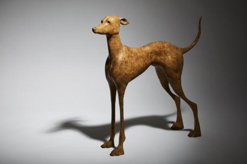 Still life of of fine art bronze sculpture - small whippet